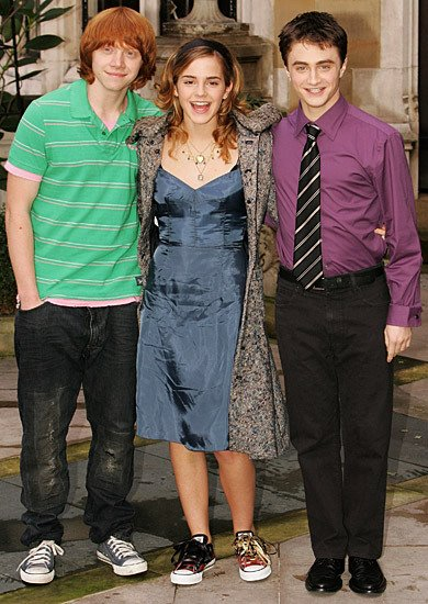 From left: Rupert Grint (in gray Converse shoes), Emma Watson (in red Converse shoes), and Daniel Radcliffe